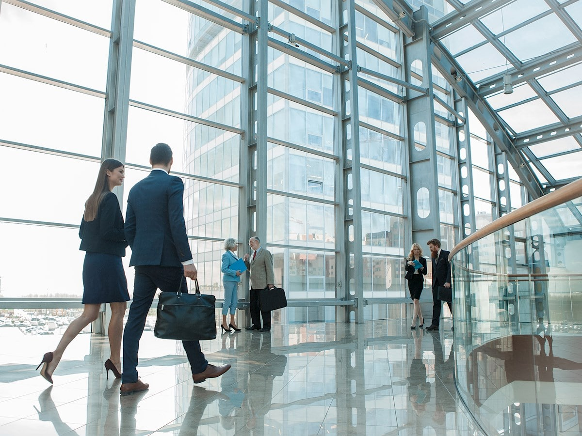 Man and woman walking in office building