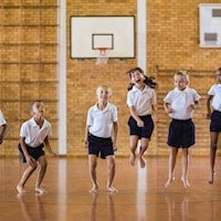 Pupils playing in school gymnasium